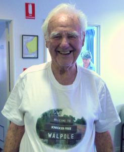Ever the larrikin, Geordie pops into the Telecentre/CRC wearing an alternative Walpole t-shirt. His great friend and supporter, Dallas Parkes, is hard at work in the background.
